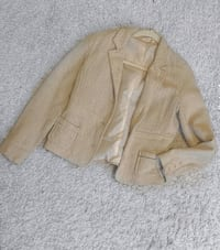 This is a beige blazer. It is super cute,comfortable & keeps you warm!