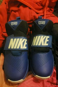 Size 4 NIKE SHOES Calgary, T3J 2X1