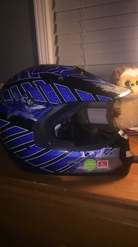 Black, blue, and white motocross helmet Guntersville