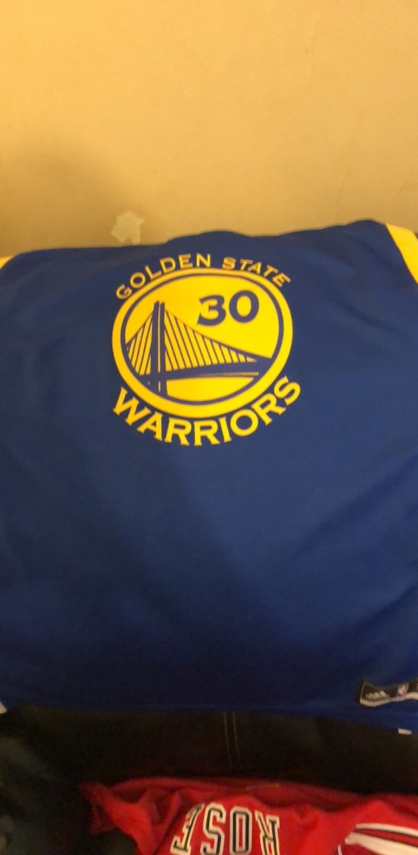 blue and yellow Golden State Warriors jersey