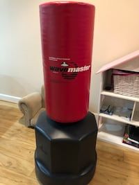 red and black Wave Master freestanding heavy bag