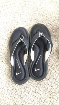 pair of black Nike flip flops Lafayette, 70508