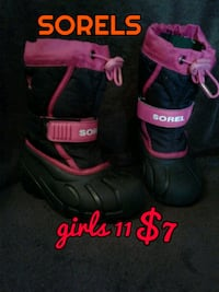 pair of black-and-pink inline skates Calgary, T3B 0T3