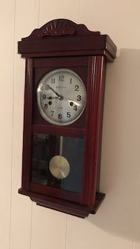 Brown wooden-framed pendulum clock chimes work and comes with key to wind clock  San Antonio, 78228