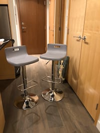 Two grey bar stools barely used , pick up close to surrey central  3717 km