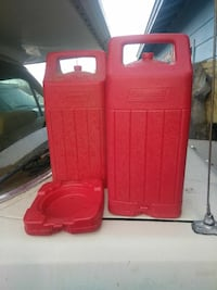 two red Coleman plastic containers