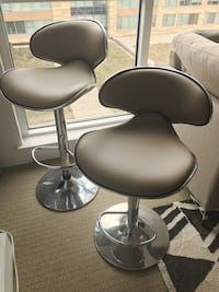 two gray leather padded salon chairs Washington, 20024
