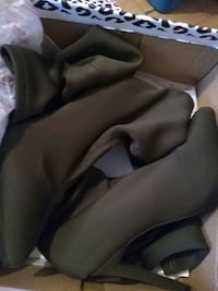 pair of black leather boots 551 km
