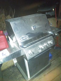 4 burner gas/propane grill w rotisserie &side burner