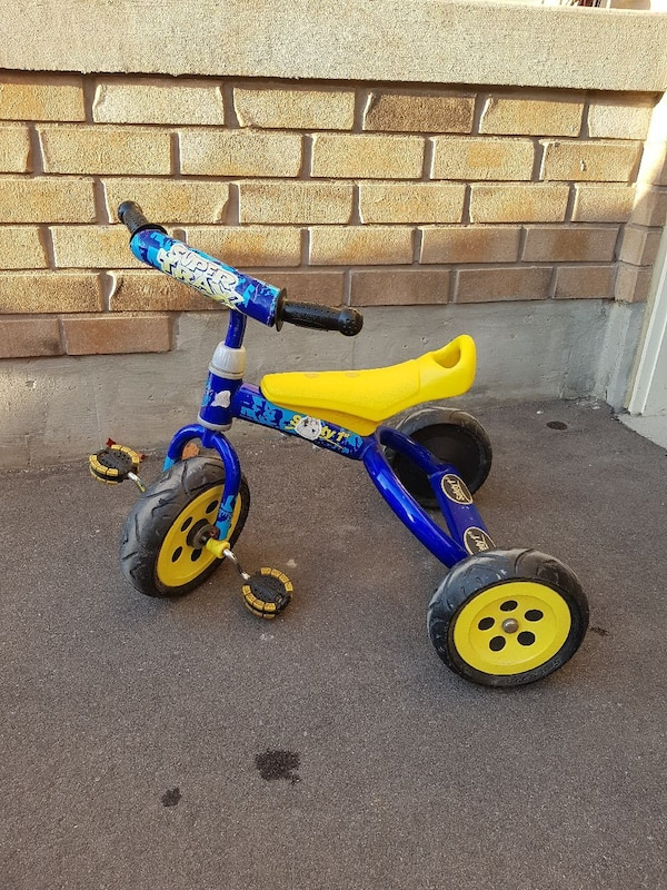 toddler's blue and yellow pedal trike