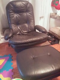Black recliner with foot rest. Toronto, M6M 1V7
