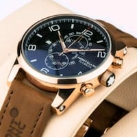round gold-colored chronograph watch with black leather strap Mississauga, L4V 1E3