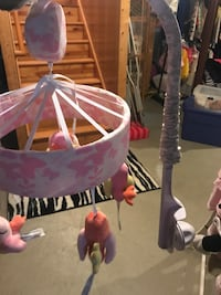 White and pink crib mobile