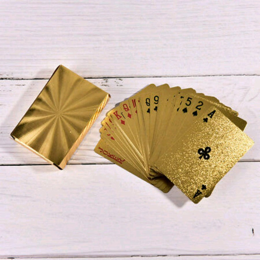 Playing cards golden plastic.