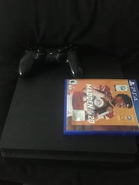 Playstation 4 with controller and Madden 20