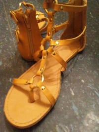 pair of brown leather flat open-toe sipper sandals Winnipeg