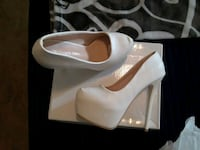pair of white leather peep-toe pumps Albuquerque
