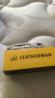 stainless steel Leatherman pocket knife with box