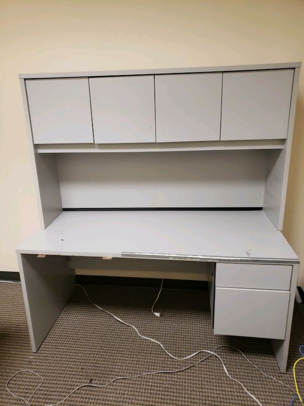 Complete office desk with cabinets.  3fab822c-2302-46c2-8e90-ff034574a467