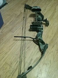 black and gray compound bow 215 mi