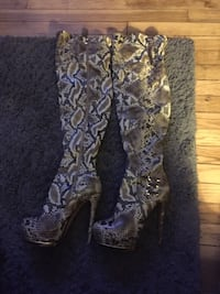Thigh high snake skin boots