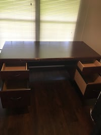 Brown wooden single pedestal desk. In good condition though some paint is chipped in the front. Orlando, 32828