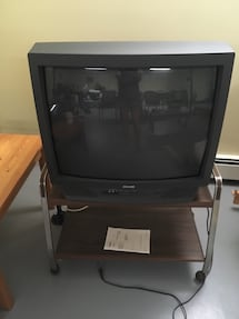 Sears 27 inch TV with stand on wheels