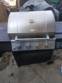 Barbecue with gas stove attached and propane tank