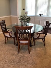 Beautiful glass dining room table (includes 6 premium wood chairs)