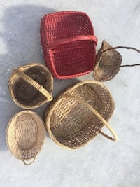 five brown and red wicker baskets