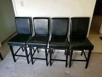 four black leather padded chairs Winnipeg, R3L 1T4
