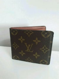 portefeuille en cuir marron Louis Vuitton Paris, 75006
