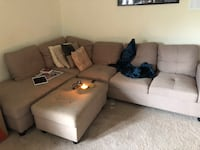 Tan fabric sectional sofa with throw pillows West New York, 07047