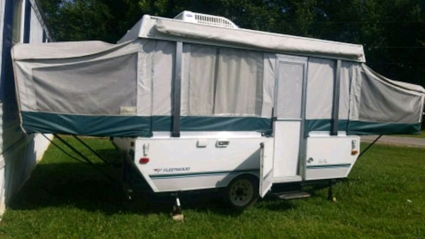 white and gray pop-up trailer