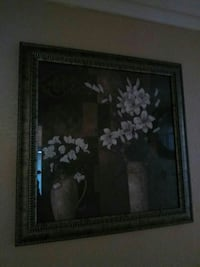 square brown-framed painting of white petaled flower