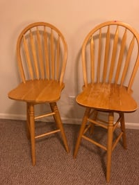 two brown wooden windsor chairs 49 km