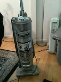 gray and black Shark upright vacuum cleaner
