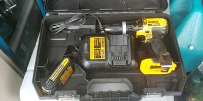 Hammer drill battery and charger