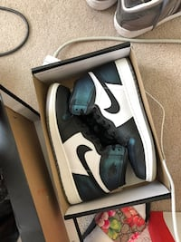 pair of white-and-black Nike sneakers Washington, 20020