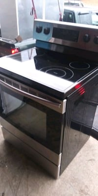Samsung black and stainless electric range