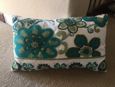 white and green floral pillow