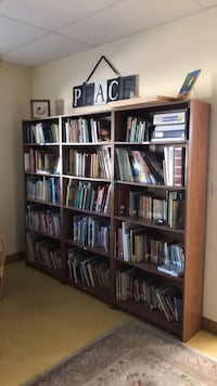 brown wooden shelf with books 643 mi
