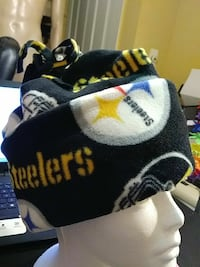 black , white and yellow Pittsburgh steelers textile