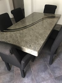 Rectangular black/ grey granite like table and 6 chairs.