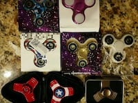 four assorted fidget spinners in boxes Tucson, 85746