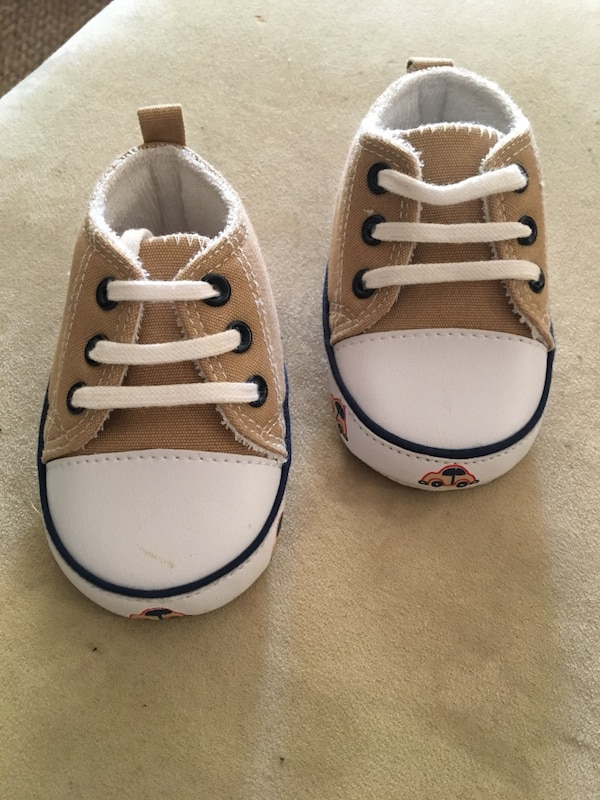 Pair of toddler's brown-and-white low-top sneakers
