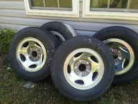 two gray 5-spoke car wheels with tires