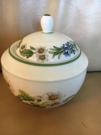 white and green floral ceramic container with lid