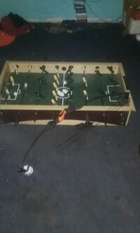 brown and beige foosball table; black compound bow Fennville, 49408