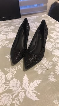 Pair of black glittered platform stilettos Montréal, H3J 1E1